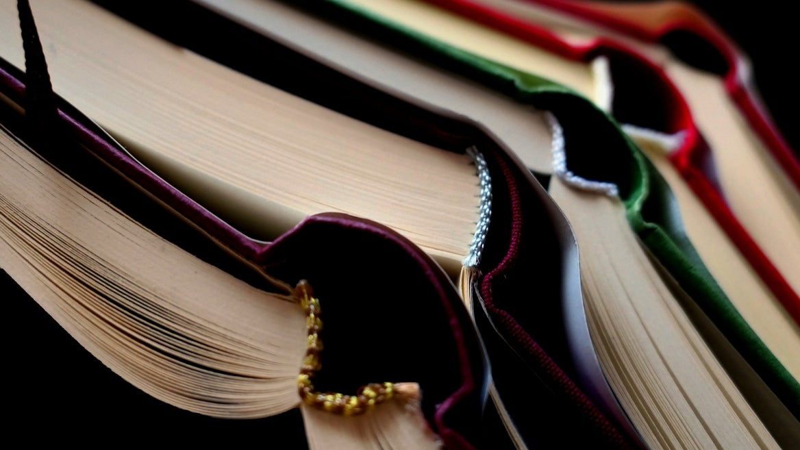 Pixabay image of open books stacked up on each other