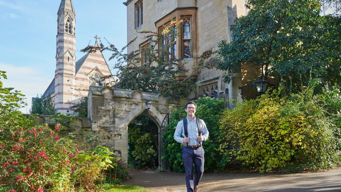 A student walks through Oxford