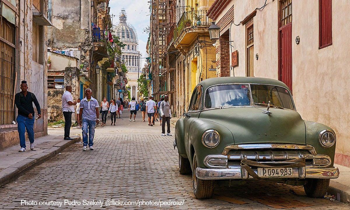 Residents and tourists walk a street near the Cuban capital.