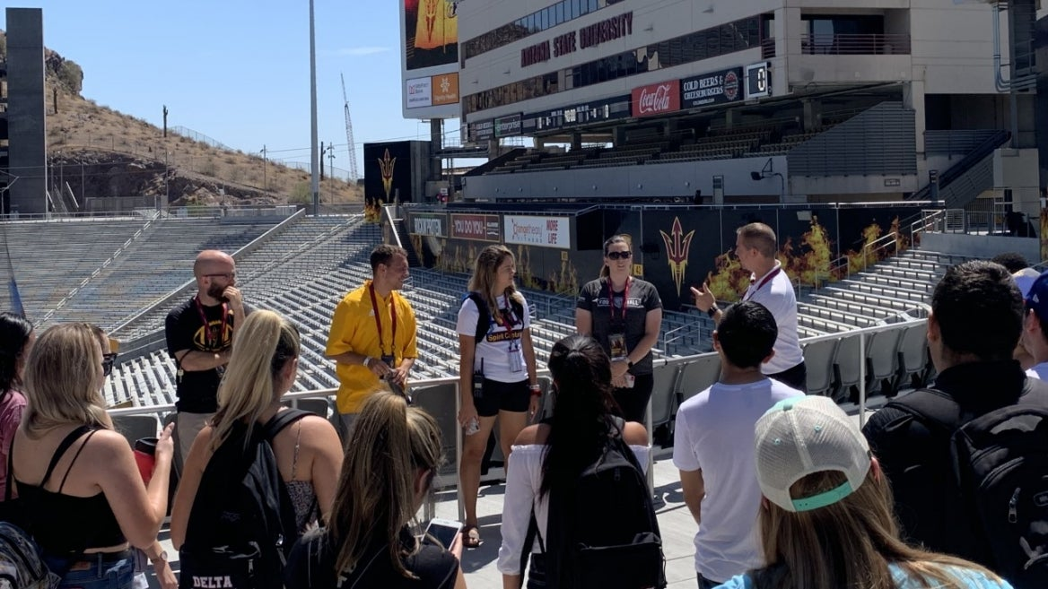 people on tour of Sun Devil Stadium