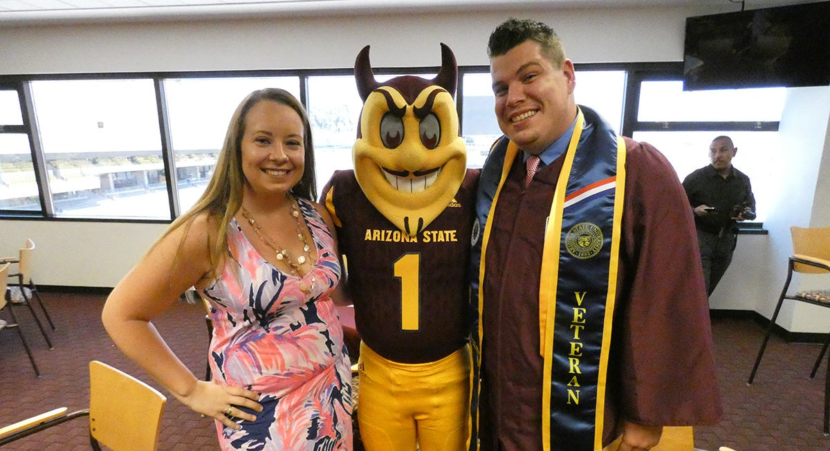 Brittany and Nick Chestnut with Sparky, ASU's mascot
